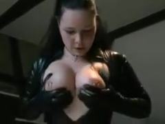 Big tits pierced brunette in spandex catsuit rides dildo