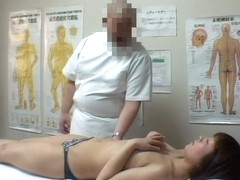 Big booty Japanese caught in a voyeur massage video