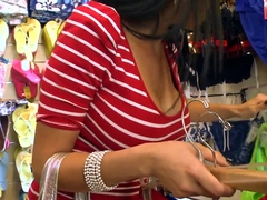 Diamond Kitty gives a blowjob in clothing store