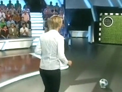Sexy girl trying to score a goal