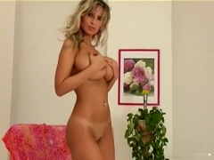 Leggy blonde cutie Molly Moris puts on quite a show while stripping