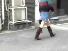 Asian babe confidently walking gets skirt sharked.