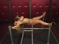 Blonde slave girl tied up and fucked with toys
