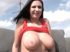 Sexy Bella Blaze shows her tits and poses on a comfy sofa
