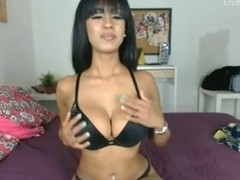 Busty Latina enjoys her handy dildo