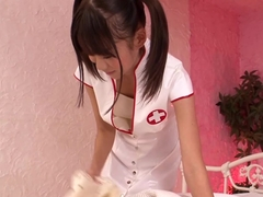 Adorable japanese nurse helps her patient with his problem