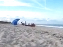 Horny daddy pisses and jerks off his penis on a black babe at the beach