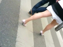 Attractive blonde lady jiggles her butt as she walks
