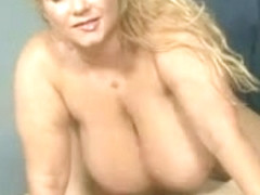 Solo mature with big boobs stripping naked on the bed