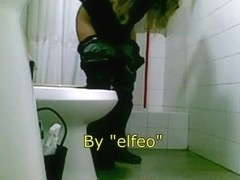 Pissing woman spied in a toilet by hidden camera
