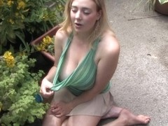 Watering the flowers in a great free down blouse video
