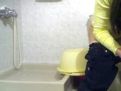 Dark-haired cutie spied while sitting her butt on a toilet