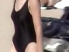 Amateur in black swimsuit on the candid beach voyeur video 07z