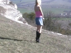 Cute russian blonde belka plays on the mountains