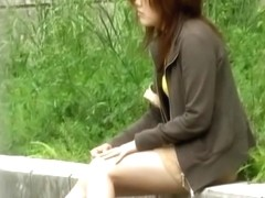 Asian babe loses some pussy hair during skirt sharking.