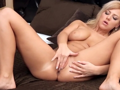 Heavy chested Nathaly Cherie polishes her honey pot
