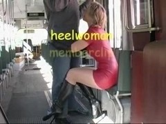Sexy Wife in Latex and High Heels Boots Sucks Strapon in Tram