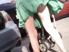 Young milf accidentally shows upskirt
