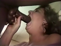 Old prostitute screams loudly while chocolate lecher is porking her hard